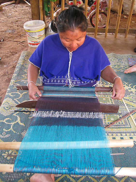 This is Mida's mother, See Taun, weaving traditional Thai Karen fabric. She is forty-one years old. Weaving is a family tradition. Both Mida and her mother learned to weave when they were eight years old. Weaving is important to Thai Karen culture, and only the women weave.