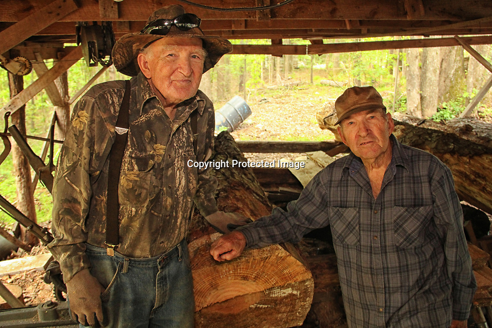 ADAM ARMOUR I BUY AT PHOTOS.ITAWAMBATIMES.COM<br /> Brothers Melvin and Walter McMillen, left to right, have been running a small sawmill for nearly 40 years. Although both in their late 80s, the siblings have hardly lost a step, and their business is still buzzing.