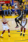 June 3, 2018; Oakland, CA, USA; Golden State Warriors forward Kevin Durant (35) dunks the ball against Cleveland Cavaliers guard JR Smith (5) during the fourth quarter in game two of the 2018 NBA Finals at Oracle Arena.