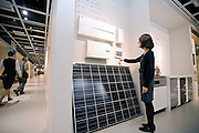 "A staffer operates an ""energy monitor"" showing energy usage, savings and other readouts from electrical devices in the ""all electrical"" line of products displayed at Panasonic Corp.'s  showroom  in Tokyo, Japan on Wednesday 14 Oct.  2009..Panasonic plans to invest $1 billion by 2012 in a plan to make its min line of business equipping homes and buildings with solar power and other energy-saving technologies. The new ""all electrical"" technology allows consumers to monitor their own electricity use."