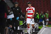 Doncaster Rovers midfielder Matty Blair (17) leaves the field injured during the EFL Sky Bet League 1 match between Doncaster Rovers and Blackpool at the Keepmoat Stadium, Doncaster, England on 17 September 2019.