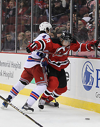 Nov 5, 2010; Newark, NJ, USA;  New Jersey Devils right wing Dainius Zubrus (8) and New York Rangers defenseman Michael Del Zotto (4) fight for the puck during the first period at the Prudential Center.