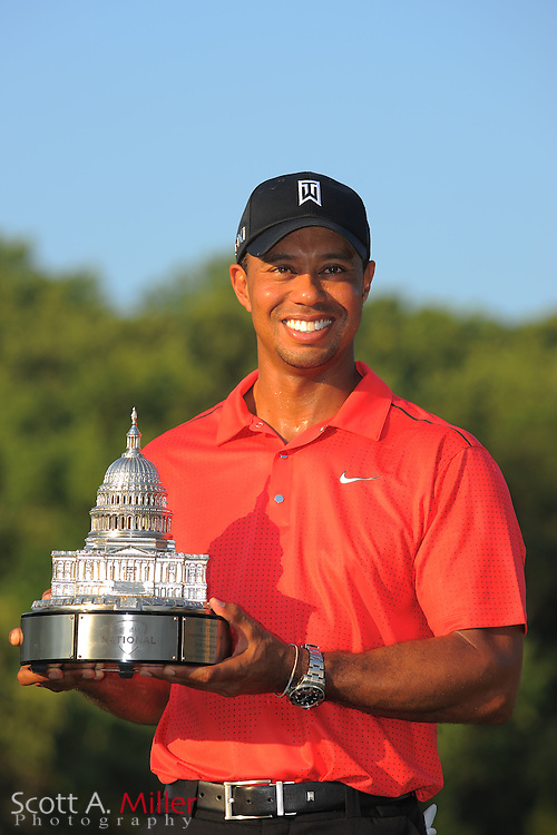 Tiger Woods with the trophy after winning the AT&T National at Congressional Country Club on July 1, 2012 in Bethesda, Maryland. ..©2012 Scott A. Miller