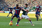 Dominic Poleon (11) of Bradford City battles for possession with Jamie Ness (6) of Plymouth Argyle during the EFL Sky Bet League 1 match between Plymouth Argyle and Bradford City at Home Park, Plymouth, England on 24 February 2018. Picture by Graham Hunt.