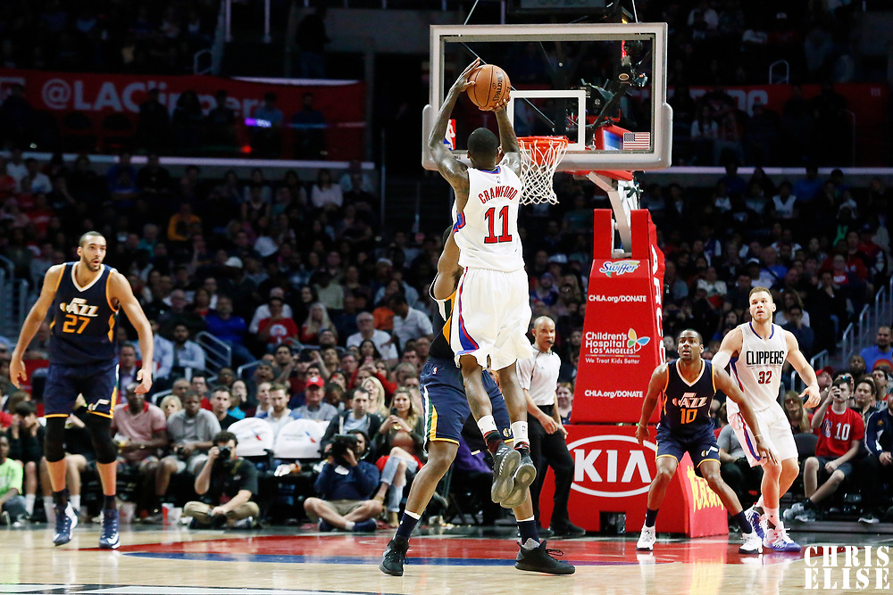 25 March 2016: LA Clippers guard Jamal Crawford (11) takes a jump shot over Utah Jazz forward Joe Johnson (6) during the Los Angeles Clippers 108-95 victory over the Utah Jazz, at the Staples Center, Los Angeles, California, USA.