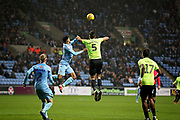 Peterborough United defender Ryan Tafazolli (5) wins this header during the EFL Sky Bet League 1 match between Coventry City and Peterborough United at the Ricoh Arena, Coventry, England on 23 November 2018.