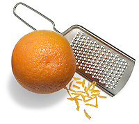 Orange zest and grater on white background