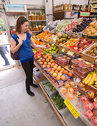 Washington DC; USA:  At the Eastern Market, one of the great markets in DC. Woman at the produce market.  Model released.  .Photo copyright Lee Foster Photo # 26-washdc79522