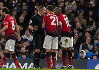 Football - 2018 / 2019 Emirates FA Cup - Fifth Round: Chelsea vs. Manchester United <br /> <br /> Referee Kevin Friend listens to the appeals from Ander Herrera (Manchester United) and Ashley Young (Manchester United) at Stamford Bridge<br /> <br /> COLORSPORT/DANIEL BEARHAM