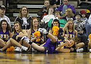 December 22 2010: Northern Iowa guard Jacqui Kalin (10) slides into the cheerleaders during the first half of an NCAA college basketball game at Carver-Hawkeye Arena in Iowa City, Iowa on December 22, 2010. Iowa defeated Northern Iowa 75-64.