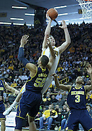 January 14, 2011: Iowa Hawkeyes forward Zach McCabe (15) puts up a shot over Michigan Wolverines forward Jordan Morgan (52) during the NCAA basketball game between the Michigan Wolverines and the Iowa Hawkeyes at Carver-Hawkeye Arena in Iowa City, Iowa on Saturday, January 14, 2011. Iowa defeated Michigan 75-59.