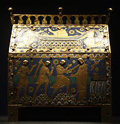 Reliquary casket of St. Thomas Becket. Gilt and copper alloy with enamel set on wood. Made around 1200 at Limoges, France. Depicts death and burial of the Saint. Thomas Becket (1118 – 29 December 1170), later also known as Thomas à Becket, was Archbishop of Canterbury from 1162 until his murder in 1170.