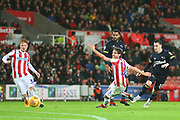 Derby County forward Tom Lawrence (10) puts the ball past Stoke City midfielder Joe Allen (4) during the EFL Sky Bet Championship match between Stoke City and Derby County at the Bet365 Stadium, Stoke-on-Trent, England on 28 November 2018.