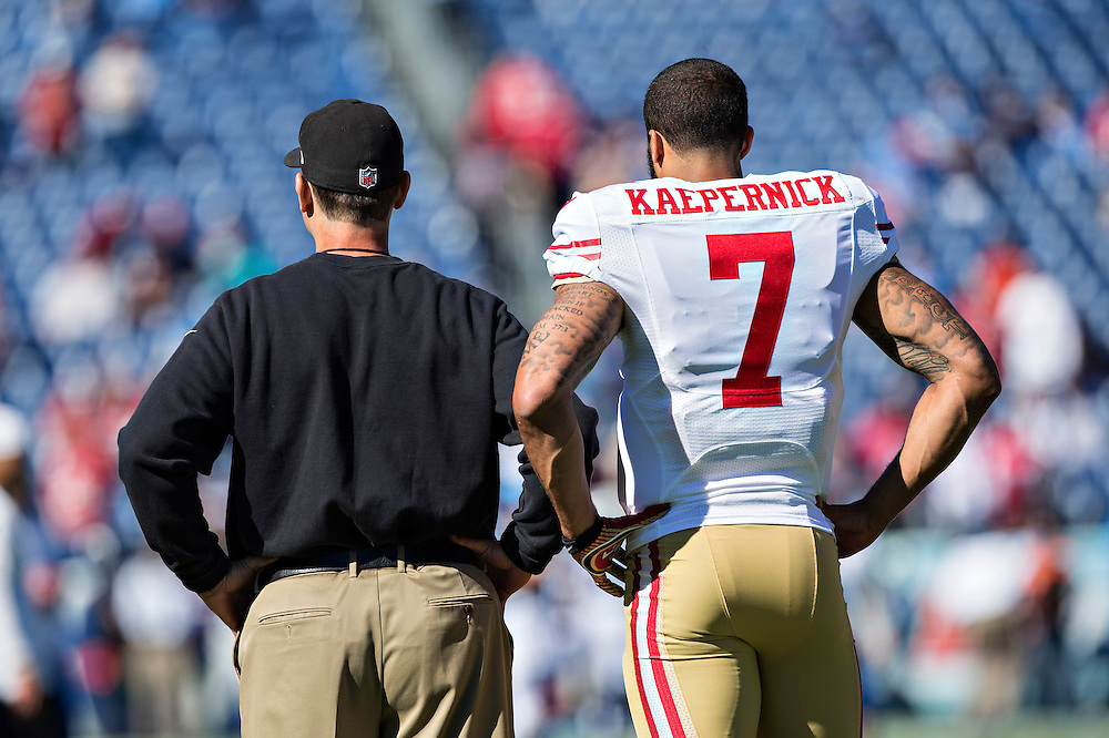 NASHVILLE, TN - OCTOBER 20:  Head Coach Jim Harbaugh and Colin Kaepernick #7 of the San Francisco 49ers stand together on the field before a game against the Tennessee Titans at LP Field on October 20, 2013 in Nashville, Tennessee.  The 49ers defeated the Titans 31-17.  (Photo by Wesley Hitt/Getty Images) *** Local Caption *** Jim Harbaugh; Colin Kaepernick