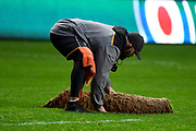 A Groundsman makes running repairs to the pitch during the Gallagher Premiership Rugby match between Wasps and Bath Rugby at the Ricoh Arena, Coventry, England on 2 November 2019.