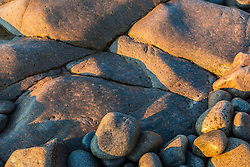 Morning sun on the rocks of the Schoodic Peninsula in Maine's Acadia National Park.