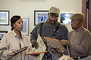 Shady Side, Maryland, US - 21 September 2009. J R Gross (center), a local waterman, at the Salem Avery Museum. J R started working for his after when he was 12, and his three sons are also watermen.