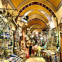 Kapaliçarşi Grand Bazaar Hallway and Shops in Istanbul, Turkey<br /> There are 22 gates leading into the Grand Bazaar, called Kapaliçarşi in Turkish, and you could probably spend the day walking around the thousands of shops and not see them all.  But after a few hours, you've probably waved off enough aggressive shopkeepers, bargained hard with a few of them, and seen enough spices, jewelry, textiles, clothing, leather and souvenirs.  What is hard to find in this 550 year old market is good bathrooms, which is a major downfall when 250,000 to 400,000 people visit there every day.  Diehard shoppers can also go to other traditional bazaars and markets (semt pazari) or several large, modern malls.