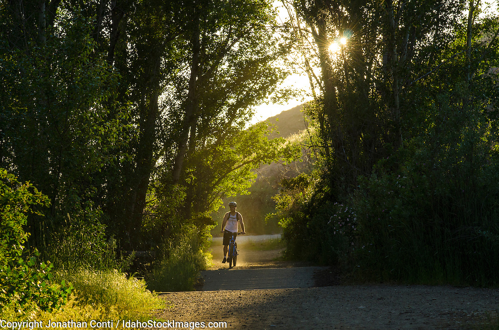 A biker begins his ride at sunset in the Boise foothills