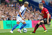 Brighton and Hove Albion midfielder Anthony Knockaert (11) takes on Manchester United Defender Luke Shaw during the Premier League match between Brighton and Hove Albion and Manchester United at the American Express Community Stadium, Brighton and Hove, England on 19 August 2018.