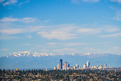 North America, United States, Washington. Seattle skyline and Olympic mountains viewed from Bellevue.