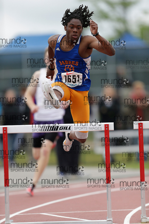 Khalil Parris of Sandwich SS - Windsor competes in the intermediate hurdle heats at the 2013 OFSAA Track and Field Championship in Oshawa Ontario, Saturday,  June 8, 2013.<br /> Mundo Sport Images/ Geoff Robins