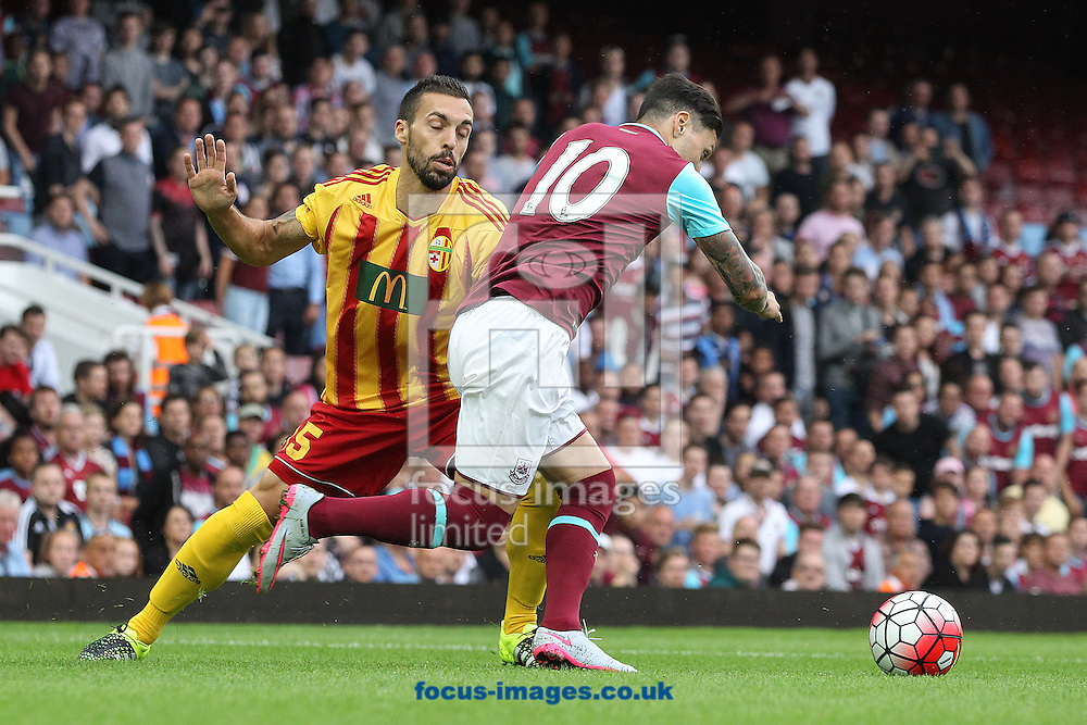 Mauricio Mazzetti of Birkirkara FC and Mauro Zarate of West Ham in action during the UEFA Europa League match at The Boleyn Ground, London<br /> Picture by Paul Chesterton/Focus Images Ltd +44 7904 640267<br /> 16/07/2015