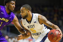 Nov 16, 2015; Charleston, WV, USA; West Virginia Mountaineers guard Jaysean Paige drives the ball to the basket during the first half against the James Madison Dukes at the Charleston Civic Center. Mandatory Credit: Ben Queen-USA TODAY Sports