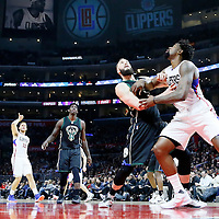 16 December 2015: Milwaukee Bucks center Miles Plumlee (18) vies for the rebound with Los Angeles Clippers center DeAndre Jordan (6) during the Los Angeles Clippers 103-90 victory over the Milwaukee Bucks, at the Staples Center, Los Angeles, California, USA.
