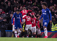 Football - 2019 / 2020 Premier League - Chelsea vs. Manchester United<br /> <br /> Manchester United players celebrate after they take a 2-0 lead  at Stamford Bridge <br /> <br /> COLORSPORT/DANIEL BEARHAM
