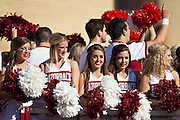 FAYETTEVILLE, AR - OCTOBER 25:  Cheerleaders of the Arkansas Razorbacks wave to the crowd before a game against the UAB Blazers at Razorback Stadium on October 25, 2014 in Fayetteville, Arkansas.  The Razorbacks defeated the Blazers 45-17.  (Photo by Wesley Hitt/Getty Images) *** Local Caption ***