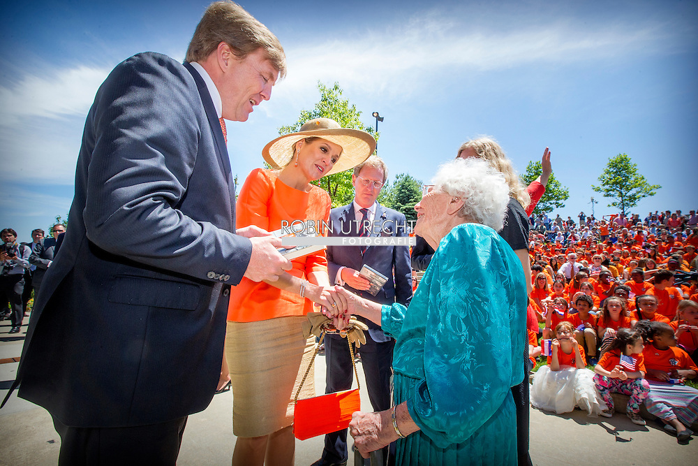 King Willem-Alexander and Queen Maxima of The Netherlands visits the open air theater at the Frederik Meijer Gardens and Sculpture Park in Grand Rapids, United States of America, 2 June 2015. At the theater they attend the ballet performance 'It is well'' about Dutch resistance fighter in WOII Diet Eman (95) who lives in Grand Rapids.The King and Queen visit the United States during an 3 day official visit. King Willem-Alexander and Queen Maxima of The Netherlands visit  Outdoor amphitheater for meeting with the Dutch Community Grand Rapids. United States, 2 June 2015.The King and Queen visit the United States during an 3 day official visit. COPYRIGHT ROBIN UTRECHT