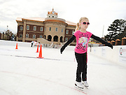 Ella Reilly, 4, skates on the newly created ice rink behind city hall in Sugar Hill. (Staff Photo: David Welker)