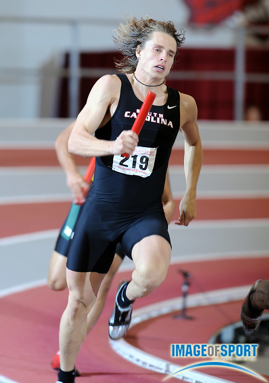 Mar 15, 2008; Fayetteville, AR, USA; Jussi Heikkila runs leg on South Carolina 4 x 400m relay in the NCAA indoor track and field championships at the Randal Tyson Center.