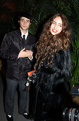 ELIZABETH JAGGER and JORDAN GALLAND at Andy & Patti Wong's Chinese New Year party to celebrate the year of the Rooster held at the Great Eastern Hotel, Liverpool Street, London on 29th January 2005.  Guests were invited to dress in 1920's Shanghai fashion.<br />