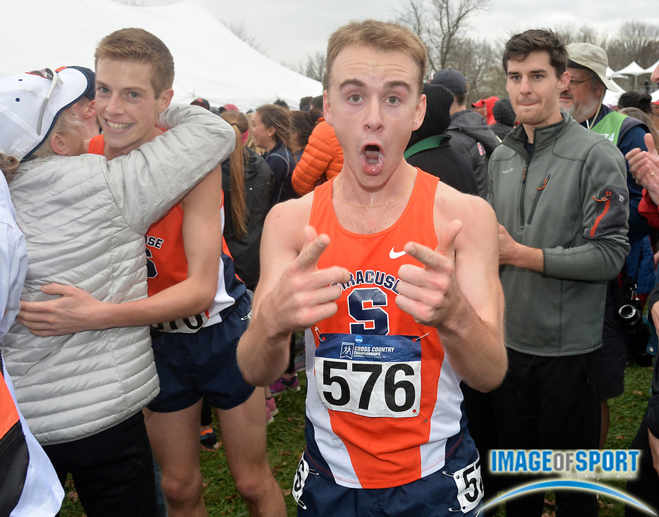 Nov 21, 2015; Louisville, KY, USA; Dan Lennon (576) celebrates after Syracuse won the team title during the 2015 NCAA cross country championships at Tom Sawyer Park. Mandatory Credit: Kirby Lee-USA TODAY Sports