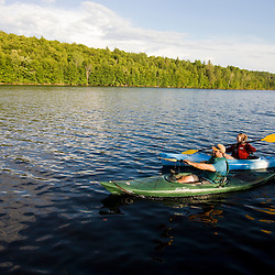 A couple kayaks on Lake Francis in Pittsburg, New Hampshire.