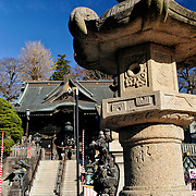 A pillar and gatehouse at the entrance of Narita-san temple. Also known as known as Shinsho-Ji (New Victory Temple), is Shingon Buddhist temple complex, was first established 940 in the Japanese city of Narita, east of Tokyo.