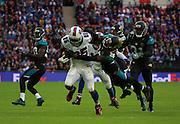 Buffalo Bills LeSean McCoy running through the Jaguars defence during the Buffalo Bills v Jacksonville Jaguars NFL International Series match at Wembley Stadium, London, England on 25 October 2015. Photo by Matthew Redman.