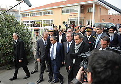 """French officials including the Minister of Defence attend a funeral service at   The """"Ozar Hatorah"""" Jewish school  on March 20, 2012 in Toulouse, southwestern France. The bodies of three French-Israeli children and a Jewish teacher killed in a gun attack began their journey Tuesday from the school where they died to their burial in Israel..The bodies were due to be flown from Paris Charles de Gaulle airport later Tuesday for a funeral in Israel. Photo by i-Images"""