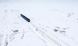 Corrour, Scotland, UK. 28 January, 2020.  A Scotrail train travels through heavy snow at Corrour on it's way from Mallaig to Glasgow on the West Highland Line. Corrour Station is the highest railway in Britain at a height of 1338 feet above sea level. Iain Masterton/Alamy Live News.