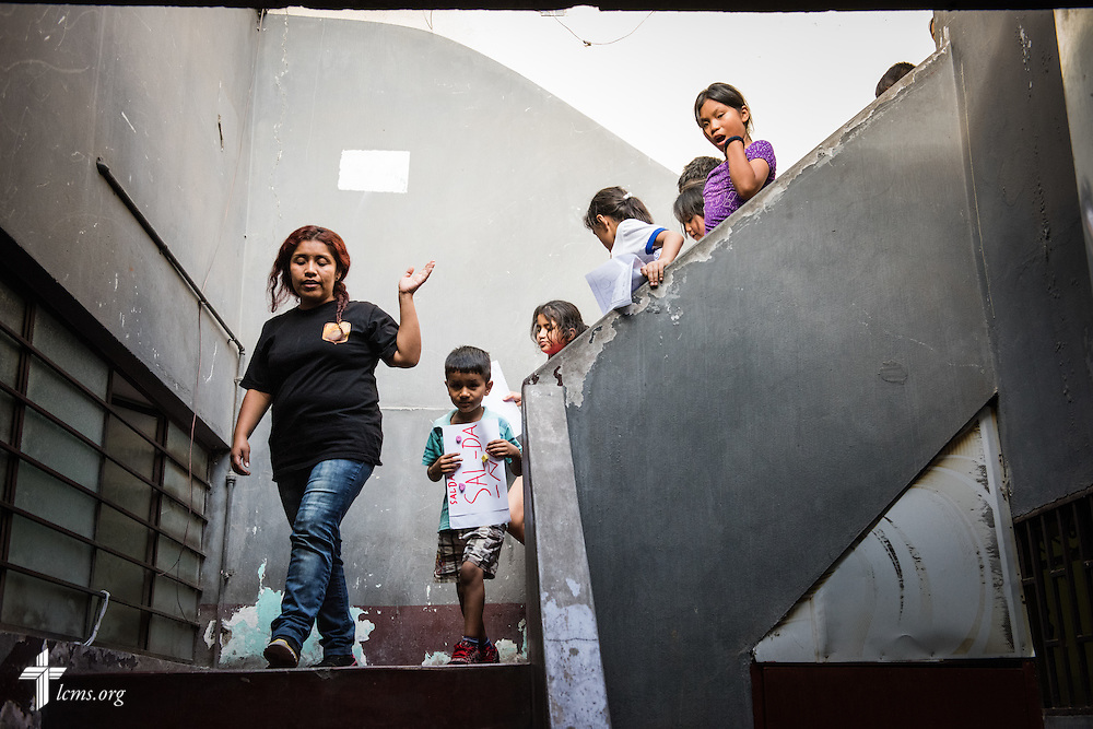 Children are led downstairs at Castillo Fuerte on Wednesday, April 8, 2015, in La Victoria, Peru. LCMS Communications/Erik M. Lunsford