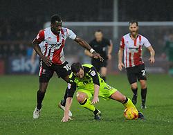 Amari Morgan-Smith of Cheltenham Town tackles Matt Oakley of Exeter City  - Mandatory by-line: Nizaam Jones/JMP- 10/12/2016 - FOOTBALL - LCI Rail Stadium - Cheltenham, England - Cheltenham Town v Exeter City - Sky Bet League Two
