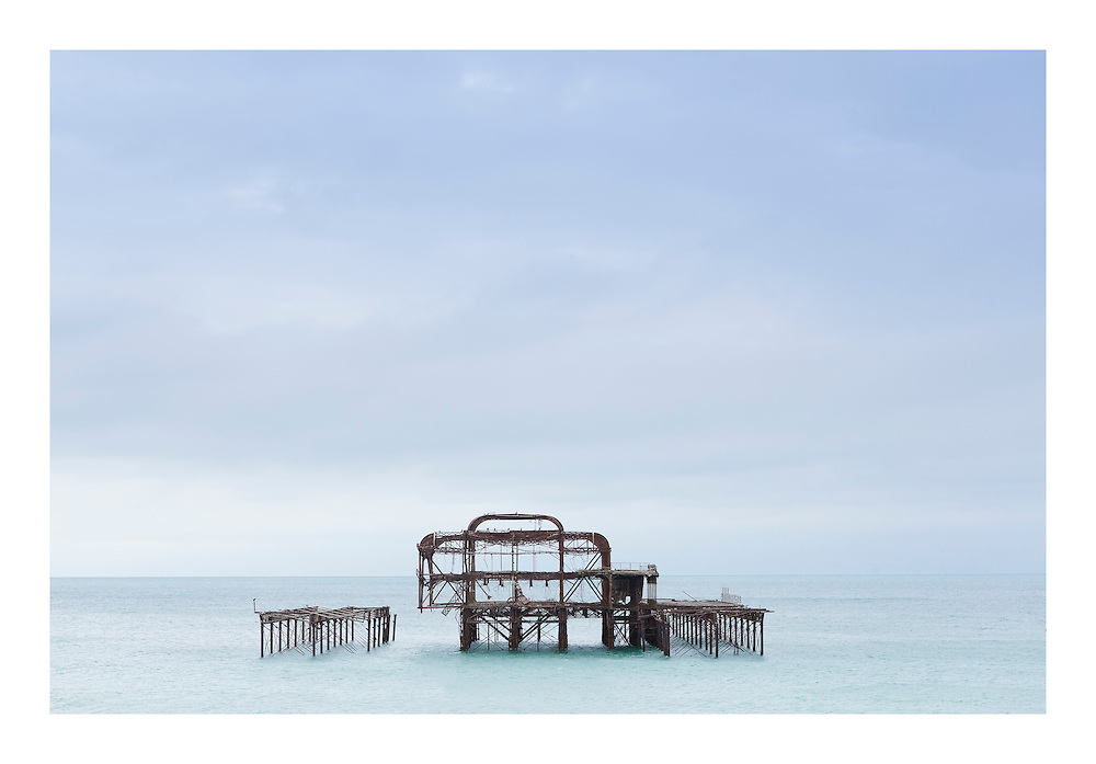 Brighton's dilapidated yet hauntingly beautiful West Pier, Sussex. View from the deck underneath the Brighton i360 tower.    //   High quality prints are available from &pound;23, with a choice of sizes and finishes. Print dimensions match readily available frames. For larger prints, we recommend professional mounting and framing. Multiple prints of similar size share one delivery charge, and next day delivery is available on orders placed before 1pm. Christmas deadline - 22nd December 2016. Full money-back guarantee if you're not happy for any reason.   //   <br /> West Pier Print for Sale by Christopher Ison &copy;<br /> 07544044177<br /> chris@christopherison.com<br /> www.christopherison.com