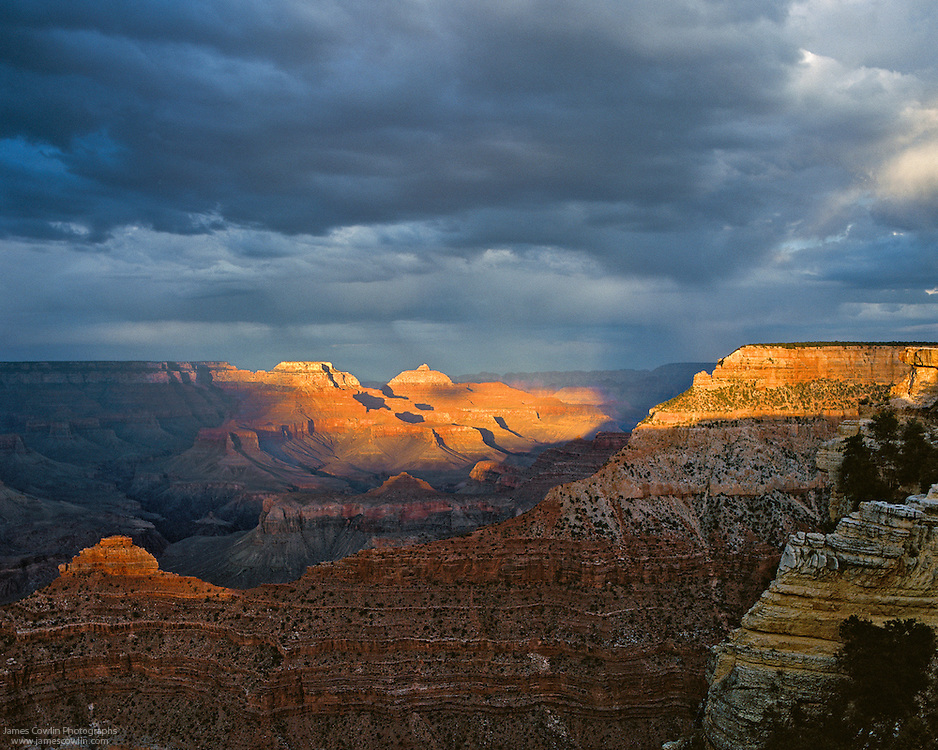Wotans Throne and Vishnu Temple highlighted at sunset from Mather Point on the South Rim of the Grand Canyon in Arizona