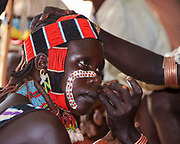 Hamer Tribesmen apply facial paint before the start of a tribal ceremony. Photographed in the Omo River Valley, Ethiopia