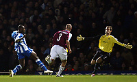 Photo: Chris Ratcliffe.<br />West Ham United v Wigan Athletic. The Barclays Premiership. 28/12/2005.<br />Jason Roberts (L) of Wigan scores the opening goal past Roy Carroll (R).