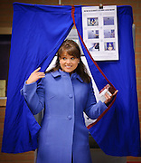 Republican Senate candidate Christine O'Donnell of Delaware leaves the polling station after casting her vote in Wilmington, Del. on Nov. 2, 2010. O'Donnell is up against Democratic nominee is Chris Coons in the much sought after seat. American voters began heading to the polls Tuesday morning in elections that will recalibrate the balance of power in Washington and in state houses across the nation. (Photography by Jim Graham)