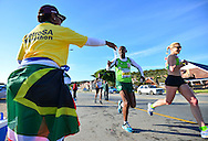 MOSSEL BAY, SOUTH AFRICA - SEPTEMBER 24: runners pass the PetroSA water table during the PetroSA Marathon finishing at Santos Caravan Park on September 24, 2016 in Mossel Bay, South Africa. (Photo by Roger Sedres/Gallo Images)