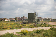 Rhome, Texas, October 11, 2013, A tank used in natural gas prodctuion in the Barnett Shale in the Shale Creek Community. <br /> <br />  The hydraulic fraturing industry is controversial as the long and short term effects of horizontal drilling are unknown.